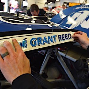 Grant Reed sticker being placed on car