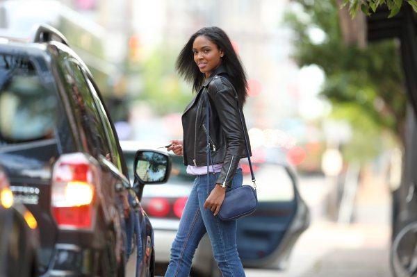 Woman standing near a black SUV