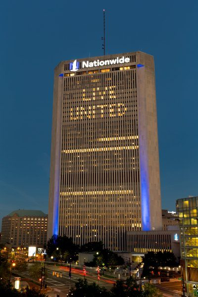 nationwide building at night with words 'live united'