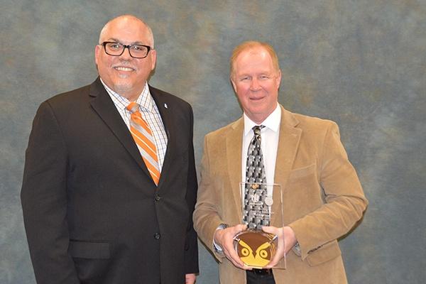 Two men receiving an award