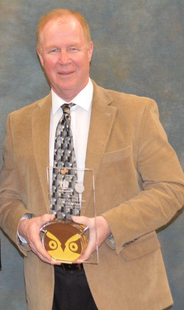 Brad Taylor holding Golden Owl trophy
