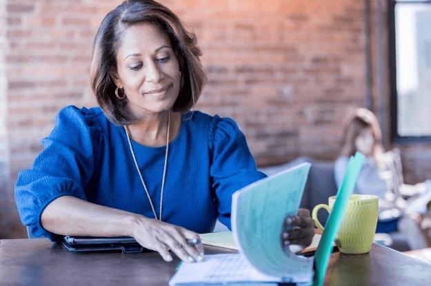 Woman reviews insurance bundling paperwork
