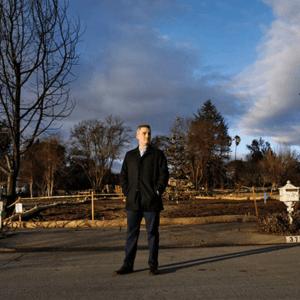 Jeff Okrepkie stands on a street