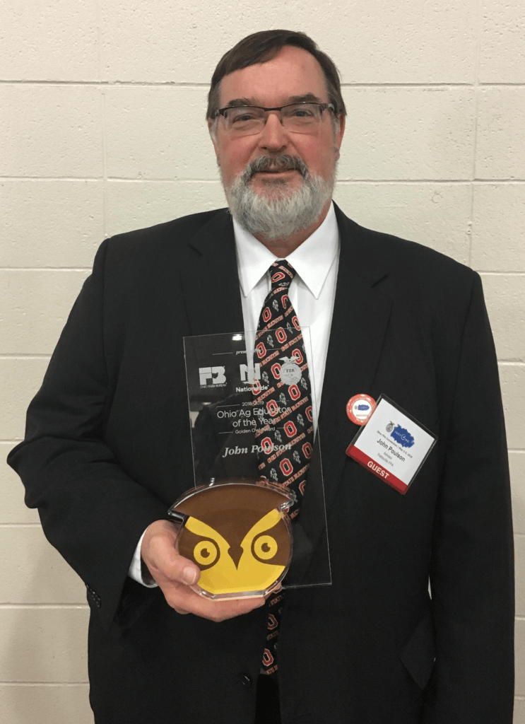 John Poulson holding golden owl trophy