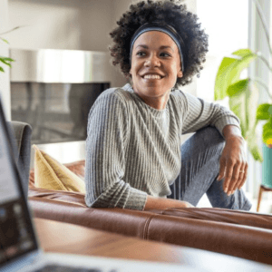woman sitting at home working