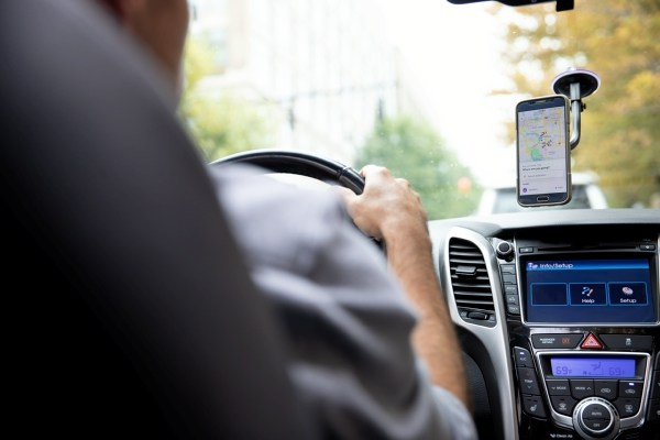 man driving car with dashboard in view