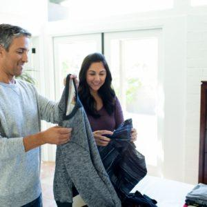 man and woman folding clothes