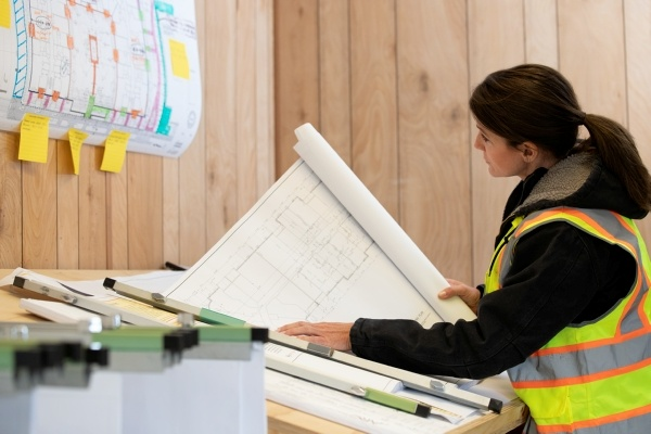 woman looking at construction plans