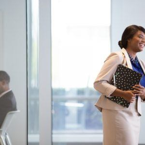 a business woman holding documents