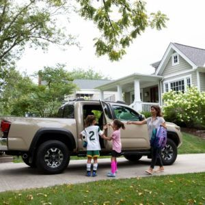 a family and a pick-up truck