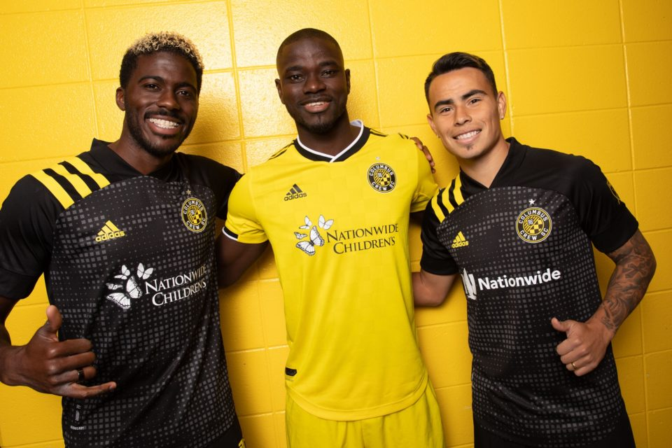 three columbus crew soccer players smiling