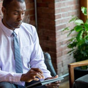 a man using a tablet device