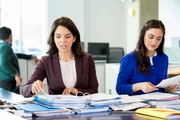 women looking at paperwork