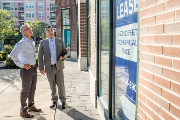 two men looking at commercial property