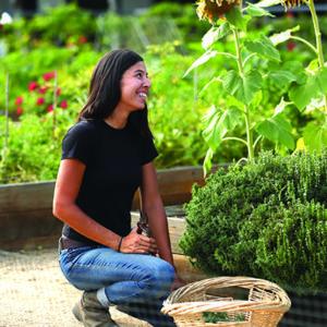 a woman tending to a garden