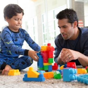 a father and son playing with toys