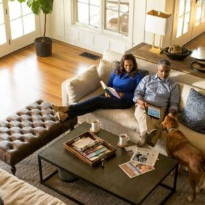 a couple relaxing in their living room