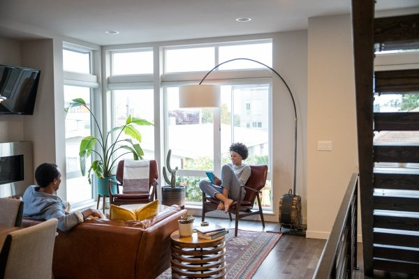 two people sitting in living room