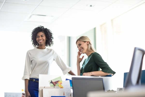 two business women smiling