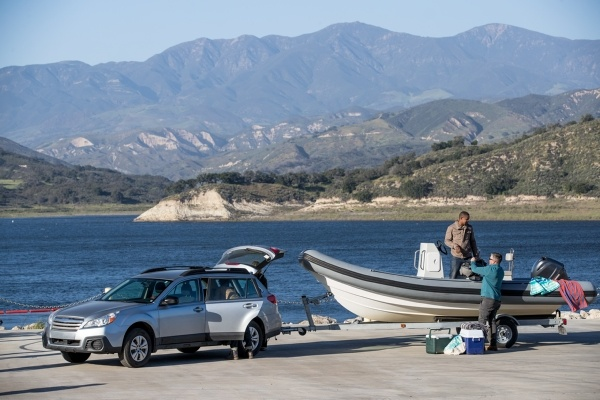 a car towing a boat