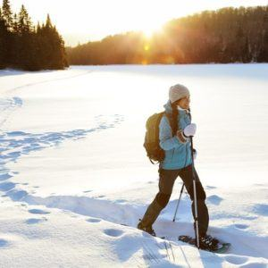 A woman snowshoeing