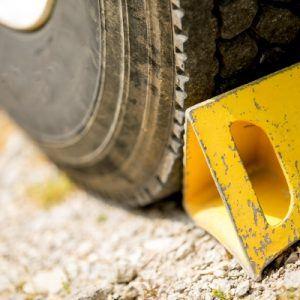 a yellow wheel stopper