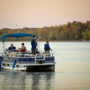 People fishing from a pontoon boat