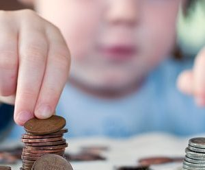 a child picking up a penny