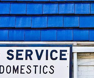 a picture of a auto body shop with text 'auto service'