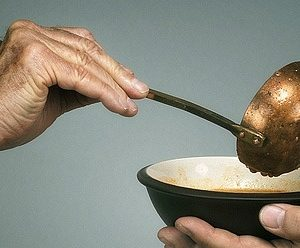 a hand holding a ladle